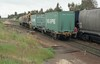MM02 shunting a grain hopper and a container wagon, Gunnedah, July 1999.