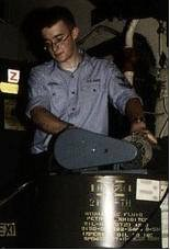 pumping oil from a large can on USS John C Stennis 2004 - Copy