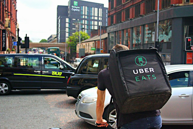UBER Eats Delivery Cyclist Riding Through a Busy Oxford Road in Manchester