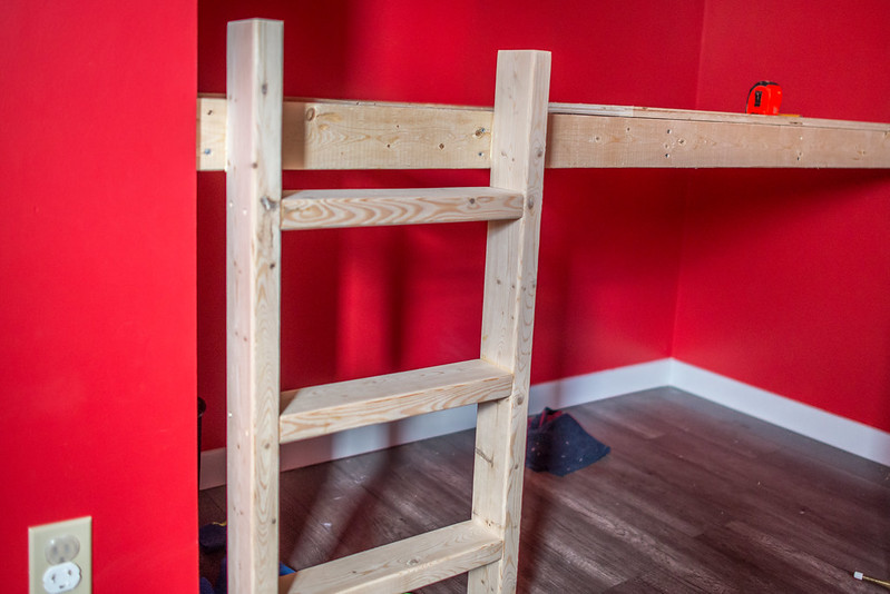 Ladder attached to bed from of reading nook