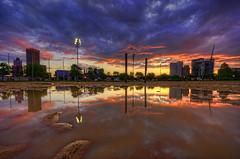 Baltimore: skyline puddle reflection sunrise