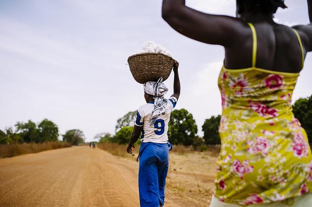Women carrying cotton