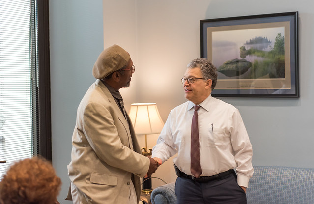 A photo of Ken Martin and Senator Franken shaking hands.
