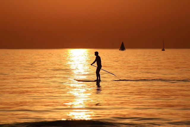 SUP Surfer & sailboats in a golden sea - Tel-Aviv beach
