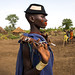 Beautiful young woman with a hat and some make up during the fat men ceremony in the Bodi tribe, Omo valley, Hana Mursi, Ethiopia by Eric Lafforgue