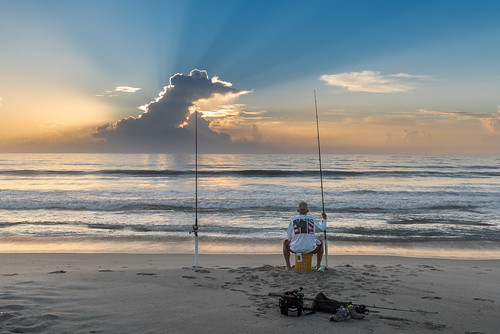indianharbourbeach sunrise clouds fisherman fishing man ocean sand surf waiting chuckpalmer