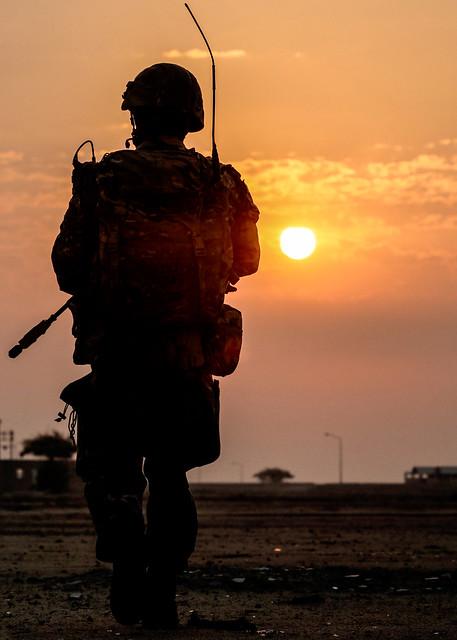 A Royal Marine Commando patrols in Kuwait