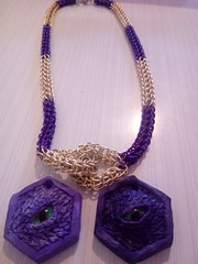 Dragon eye with a chain mail necklace
