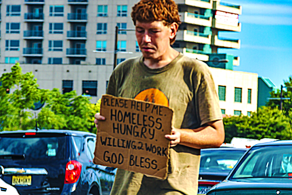 Young man with PLEASE HELP ME HOMELESS HUNGRY sign on 7-8-27--Delaware Avnue