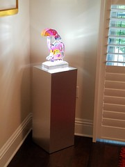 Brushed Aluminum Laminate Pedestal with Spotlight