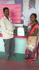 Mr.Gunalan receiving Malathi,Sivakumar,Dinesh Kumar,Shankar - RG PATTA Documents from Mrs.Neelaveni