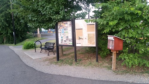 Map sign, bulletin board and Little Free Library at the Rhode Island Avenue pedestrian bridge trailhead, Metropolitan Branch Trail