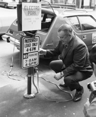 City Light Superintendent Gordon Vickery with prototype electric car, 1973