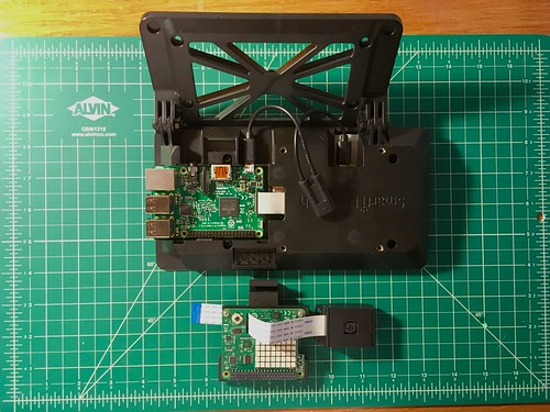 Raspberry Pi camera module with mounted Raspberry Pi and SmartiPi Touch case