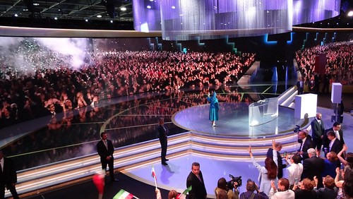 Maryam Rajavi and audience in Free Iran gathering applaud live contact with PMOI freedom-fighters in Albania, Villepinte, July 1, 2017