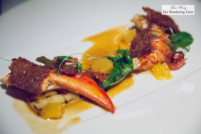 Grilled and butter poached lobster, grilled pineapple, gaeng dang red curry sauce, pickles, fried rice, orange