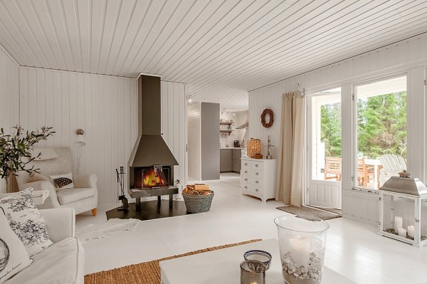 A Small White House in the Woods of Sweden