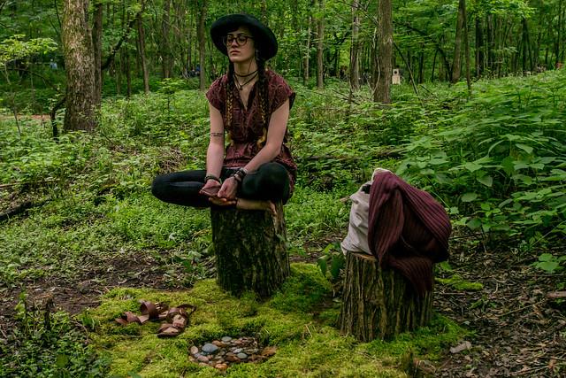 Girl Meditating in Woods
