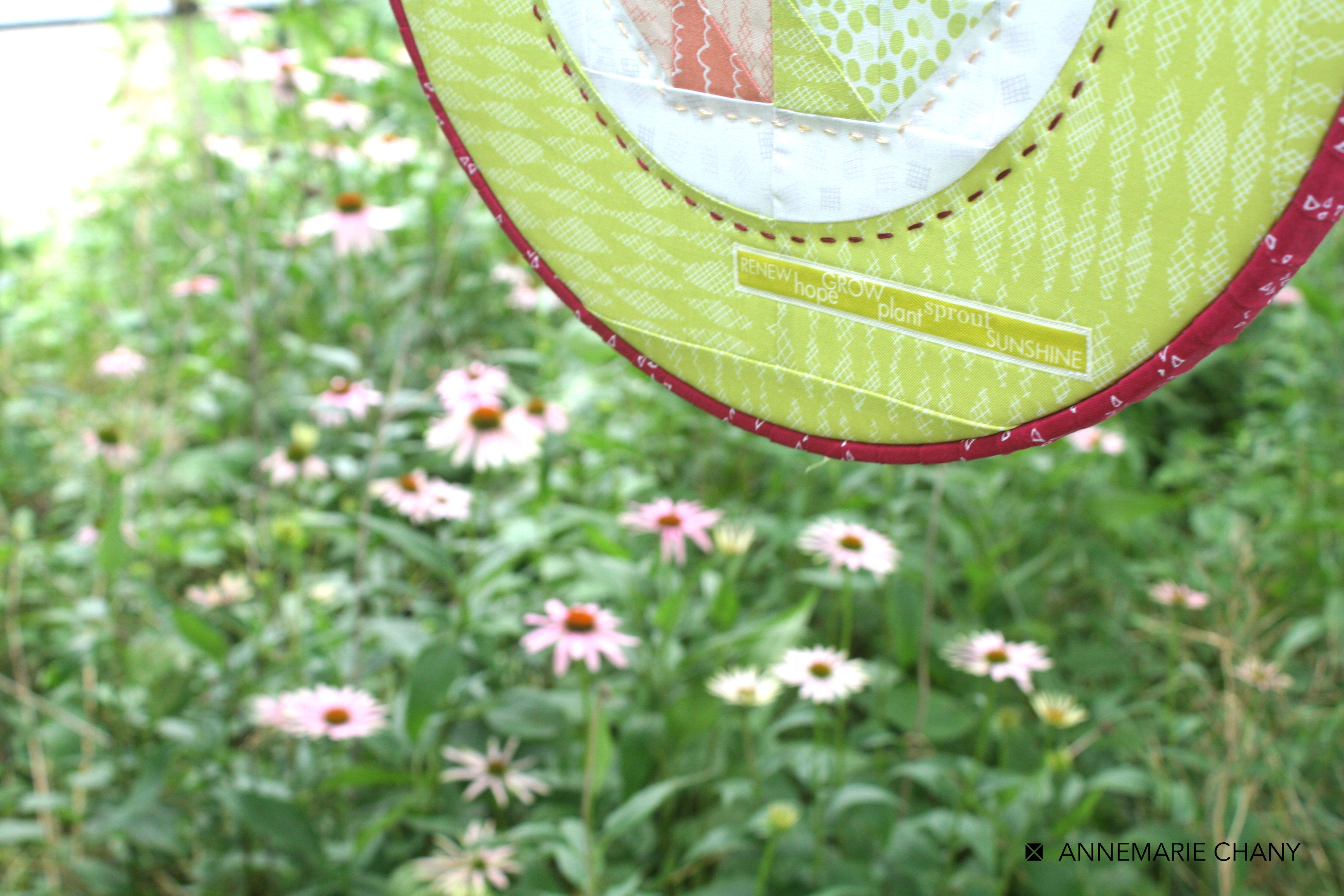 Improv Hoop Quilt close up label and flowers by AnneMarie Chany