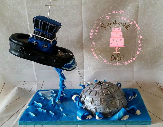 Tug Boat Pulling Out a Death Star Cake by Julie Skennerton