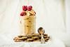 Healthy chocolate banana ice cream, raspberries in a glass jar