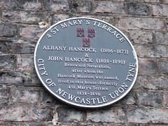 Photo of Albany Hancock and John Hancock black plaque