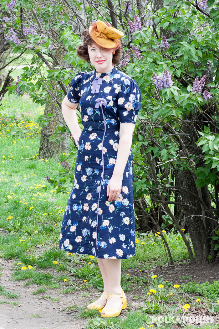 Late 1930s navy floral dress with yellow 1940s jersey tilt hat and yellow shoes