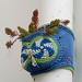 Blue knitted planter on a pipe in Paris, 13th arr by Monceau