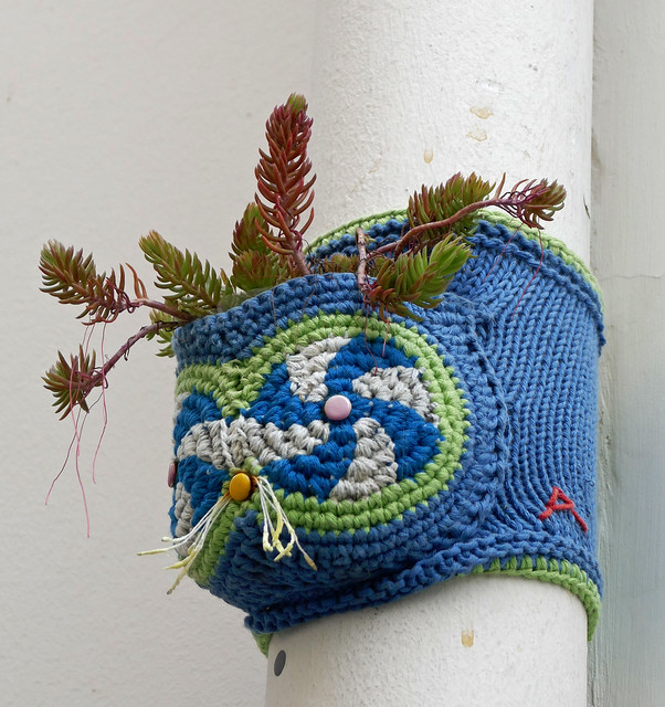 Blue knitted planter on a pipe in Paris, 13th arr