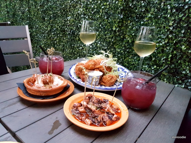 tapas and drinks on a patio