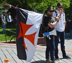"Young man displays a Nazi battle flag at the ""Stop Sharia Law"" rally in Denver."