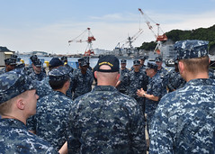 Rear Adm. Greg Fenton thanks the crew of the Navy Tug Seminole (YT 805) for their work in assisting USS Fitzgerald (DDG 62). (U.S. Navy/MC2 Richard L.J. Gourley)