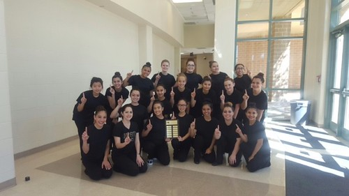 Dance students celebrating their first division rating at the Dance Education Assessment of Learning competition