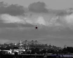 RED HELICOPTER AGAINST THE GREY