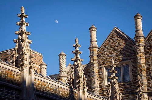 """Cricketers finials"" and ""chimney pots"" reach for the moon over the Divinity School. #dukephotoaday #pictureduke #gothicwonderland #architecture PC: Bill Snead/@dukephotoaday"