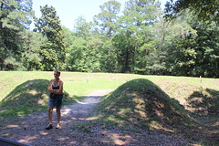 Mom next To An Earthwork