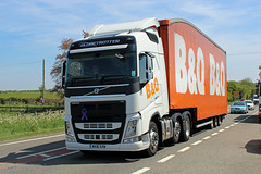 B & Q WX16 GXN, Volvo FH at Birdlip