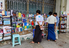 Selling old books on street in Yangon, Myanmar.