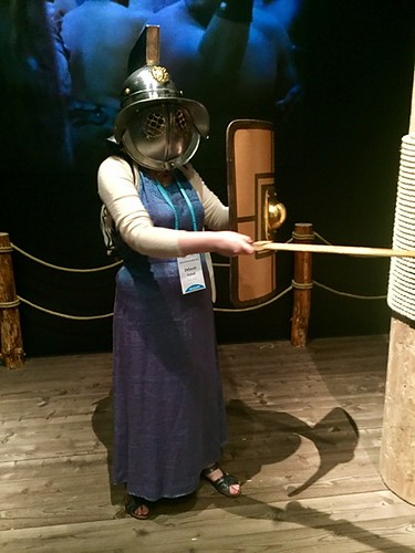 me in a nice dress and gladiator helmet, with sword and shield
