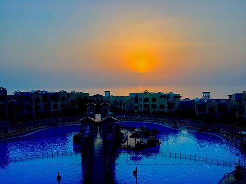 sky sunlight sun blue orange yellow sunset landscape crownplaza hotel spa resort pool water lake saltlake sea deadsea middleeast levant palestine westbank jordan