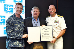 Lt. Cmdr. Christopher Keithley poses for a photo with Jeff Brown, president of Navy League U.S. Pacific Region, and Adm. Scott Swift after receiving the Navy League Scroll of Honor, June 2. (U.S. Navy/MC1 Phillip Pavlovich)