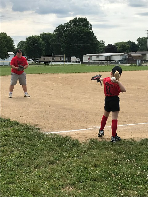 Warming up with dad for tee ball