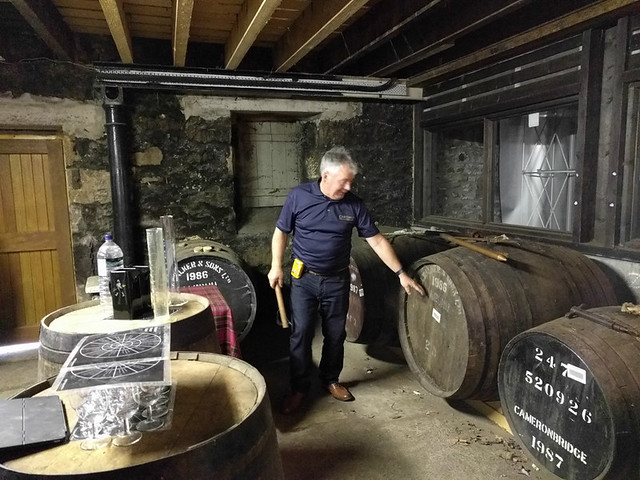 Buzz showing off the old casks