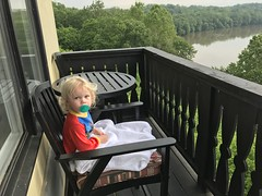 I sit Madeline out on our back balcony overlooking the Potomac this morning