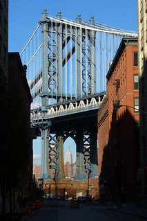 Empire State Building seen through Manhattan Bridge at Washington St in DUMBO in Brooklyn in in New York City, NY