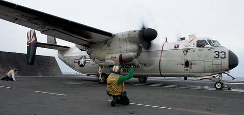 C2-A Greyhound plane transports congress members to visit USS Ronald Reagan