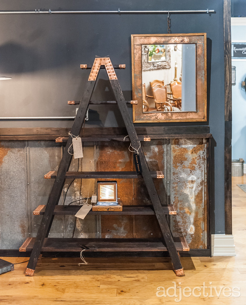 Custom wooden and metal bookcase in Winter Park by Urban Design