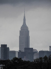 Empire State Building Touching The Clouds; photographed from Flushing, New York