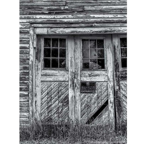 The Agriculturist, an abandoned shed in the American Heartland...  #blackandwhite #bw #capturewisconsin #wisconsin #america #heartland #building #doors #abandoned #signs #agriculture #natgeo #explore #natgeous