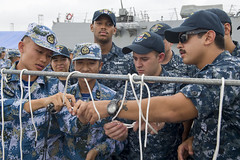 USS Sterett (DDG 104) and PLAN Sailors practice tying knots together before a seamanship competition during the ship's port visit. (U.S. Navy/MC1 Byron C. Linder)